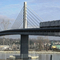 Canada_line_crossing_bridge-web_small_square